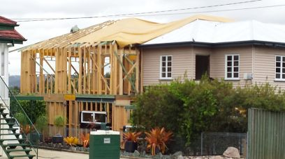 A house being extended, others have been knocked down & new houses built.