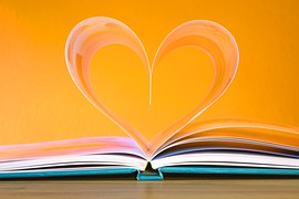 open book with two pages folded in the shape of a heart