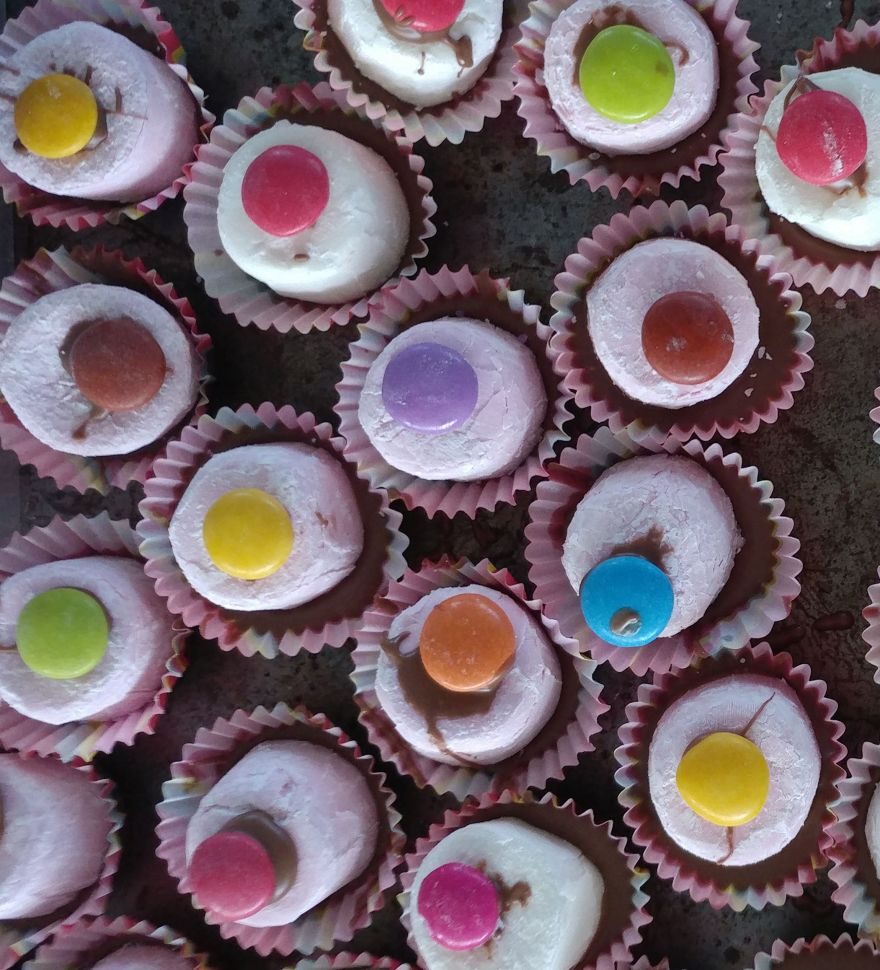 Frog's Eyes - marshmallow sitting in a chocolate in a mini patty pan, topped with a smartie