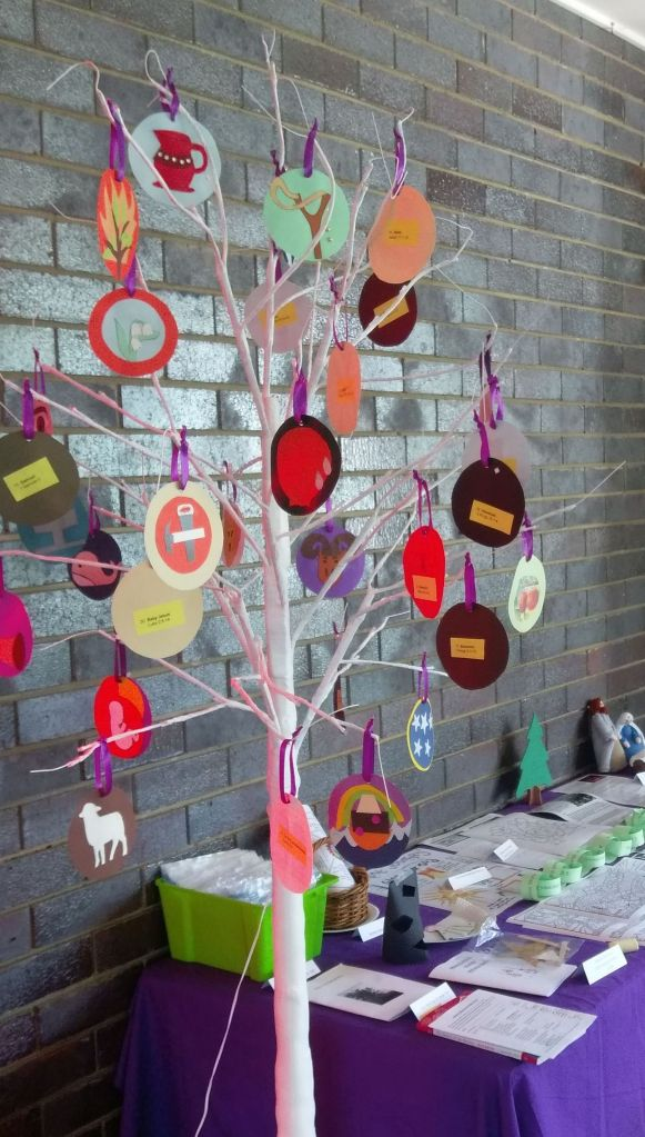 White Jesse Tree with coloured cardboard ornaments