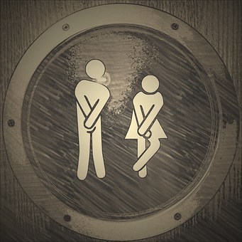 toilet sign of male and female needing to go